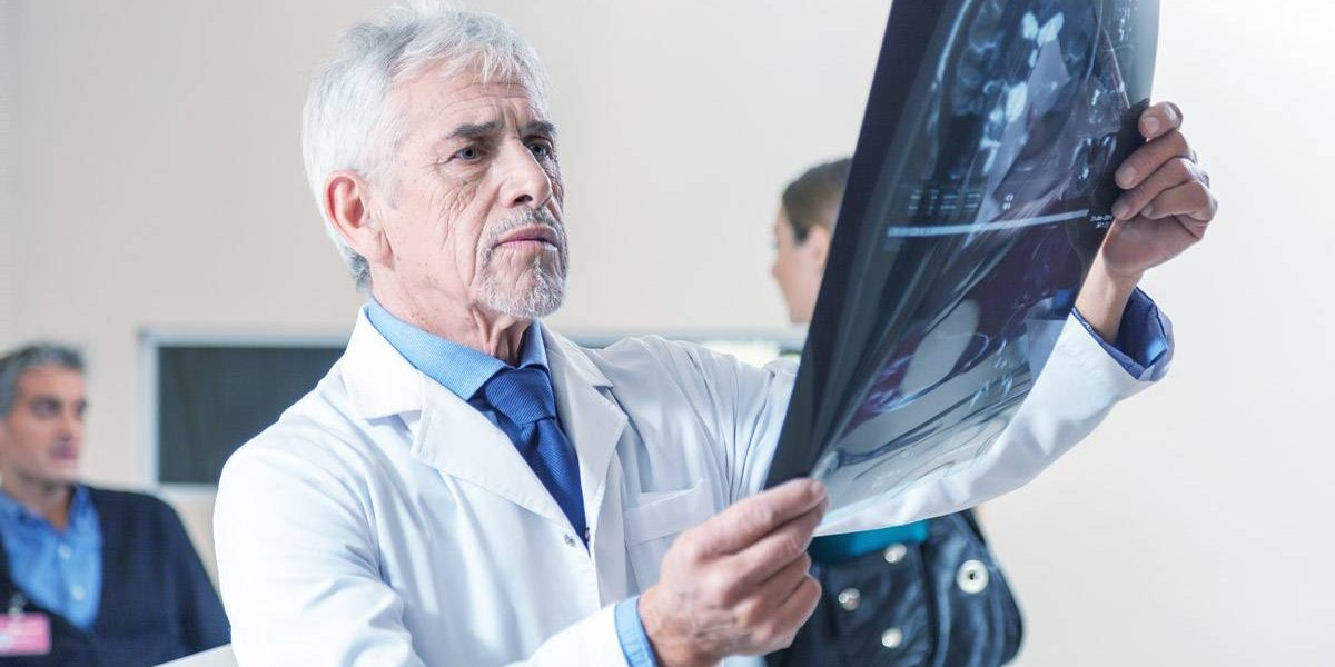 Doctor Looking at Xrays